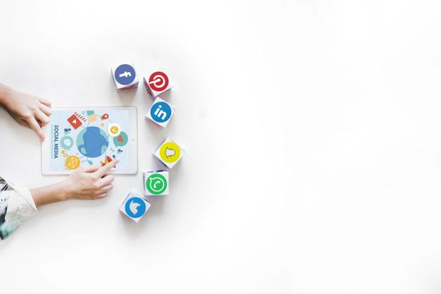 social media logos around tablet